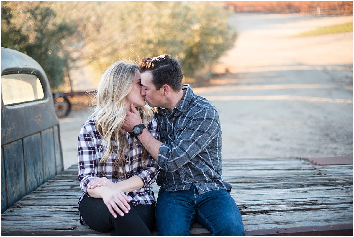 Pomar Junction Winter Engagment in Paso Robles, California with plaid and sweaters