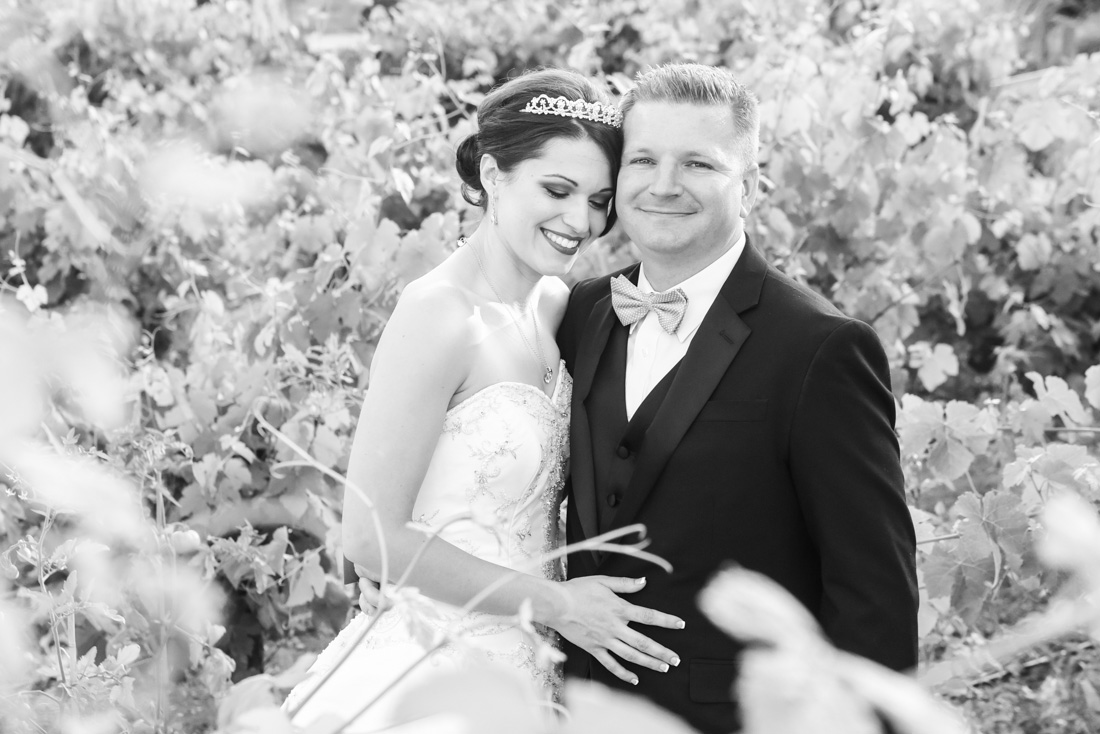 Still Waters Vineyard, in Paso Robles, CA May Spring Wedding with teals and black and white of bride and groom